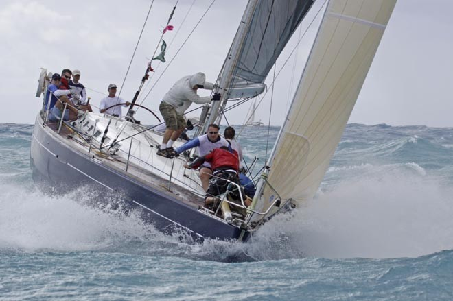 sailors sailing in rough conditions